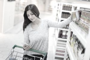Woman grocery shopping with app.