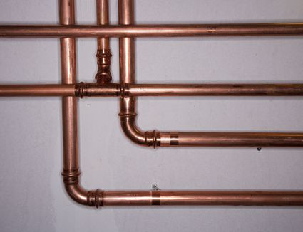 Common pipe materials used in the home for Copper pipes vs plastic pipes