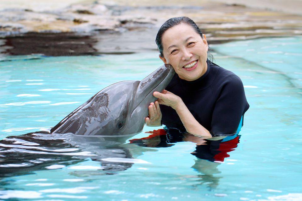Dolphin kiss a woman