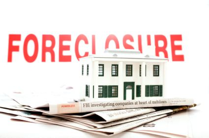 Foreclosure sign and newspaper.