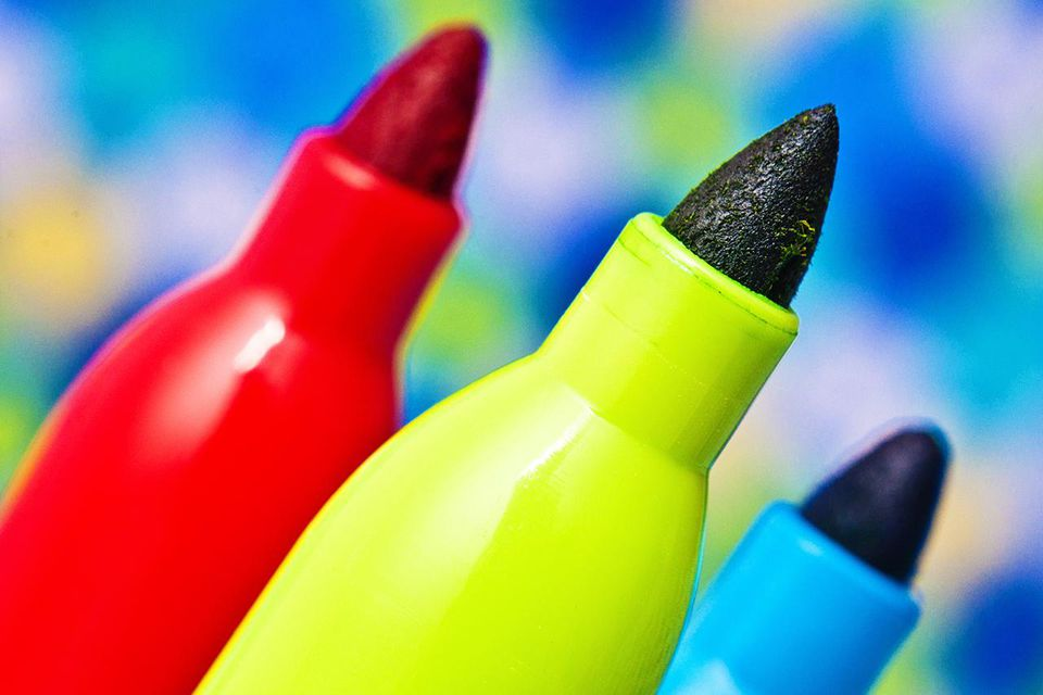 Red, yellow, and blue macro market pens