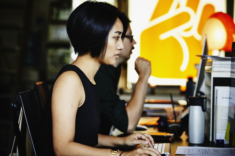 Businesswoman at workstation of startup office