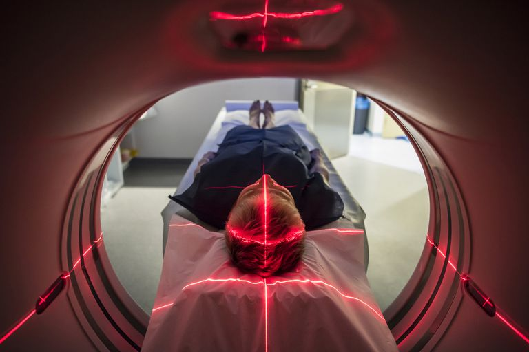 A patient lying inside an MRI machine.