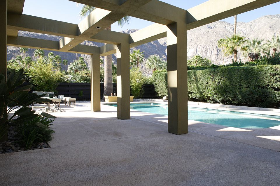 Image: a lavish concrete patio.