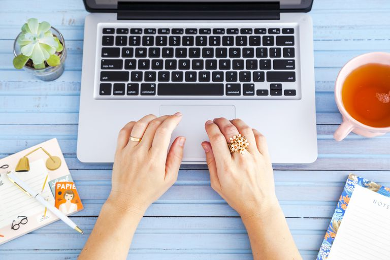 Woman's hands at the laptop