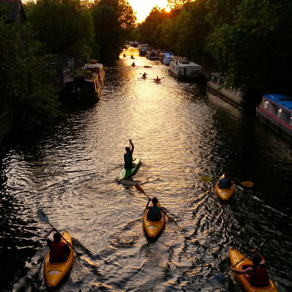 People canoeing on regent's canal at dusk