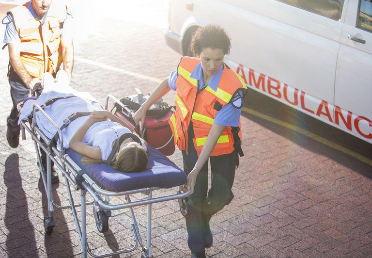 Paramedics wheeling patient into hospital