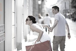 Young Couple Enthusiastically Window Shopping