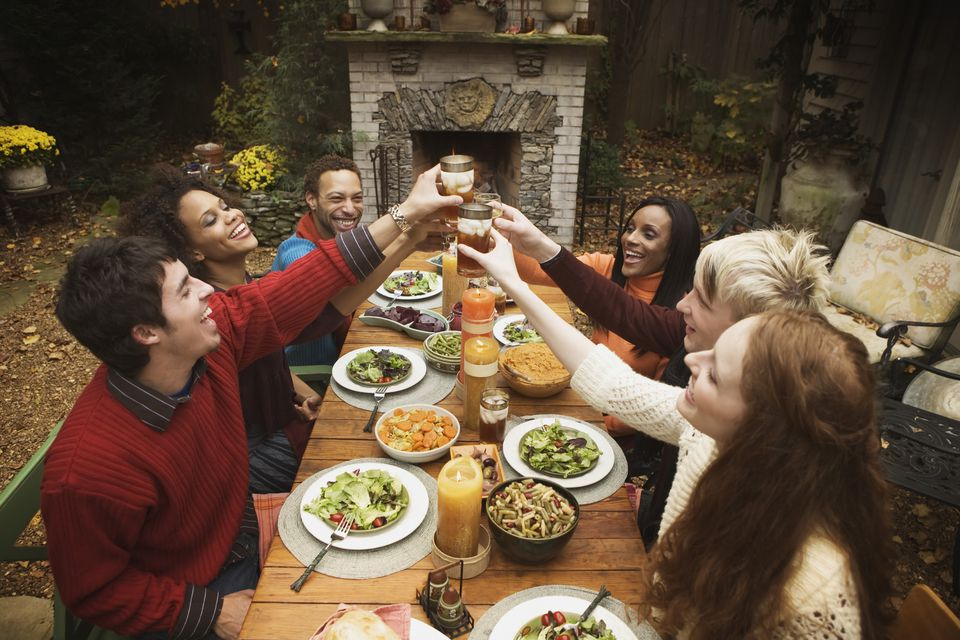 Friends dine outdoors in the fall