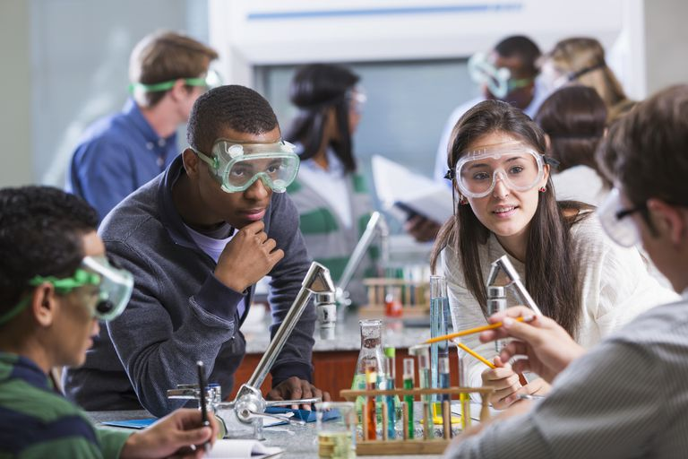 Group of multi-ethnic students in chemistry lab