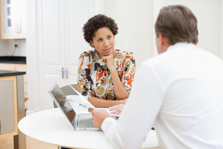 woman in meeting - Financial Advisor Interview Questions And Answers