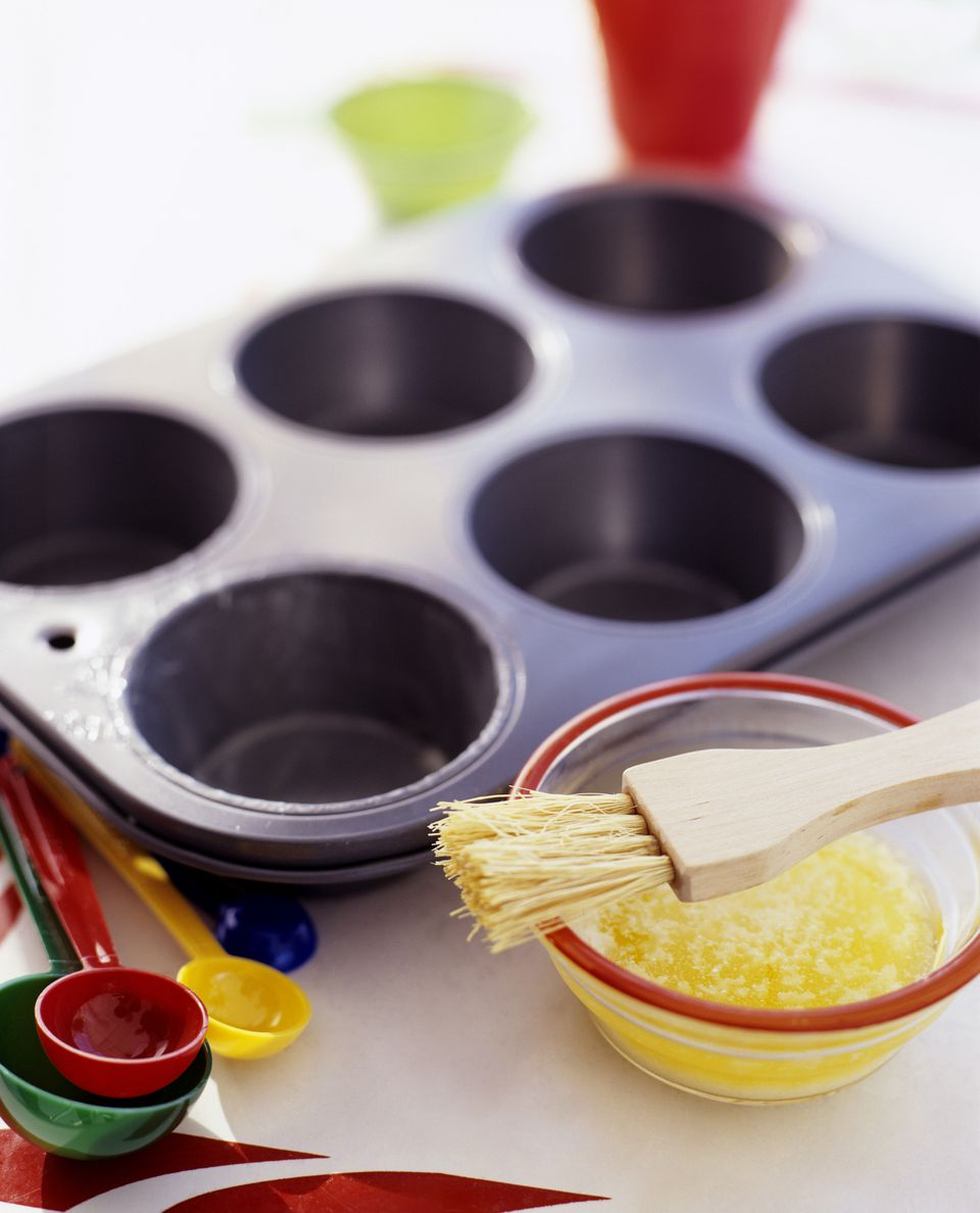 Muffin tin and melted butter