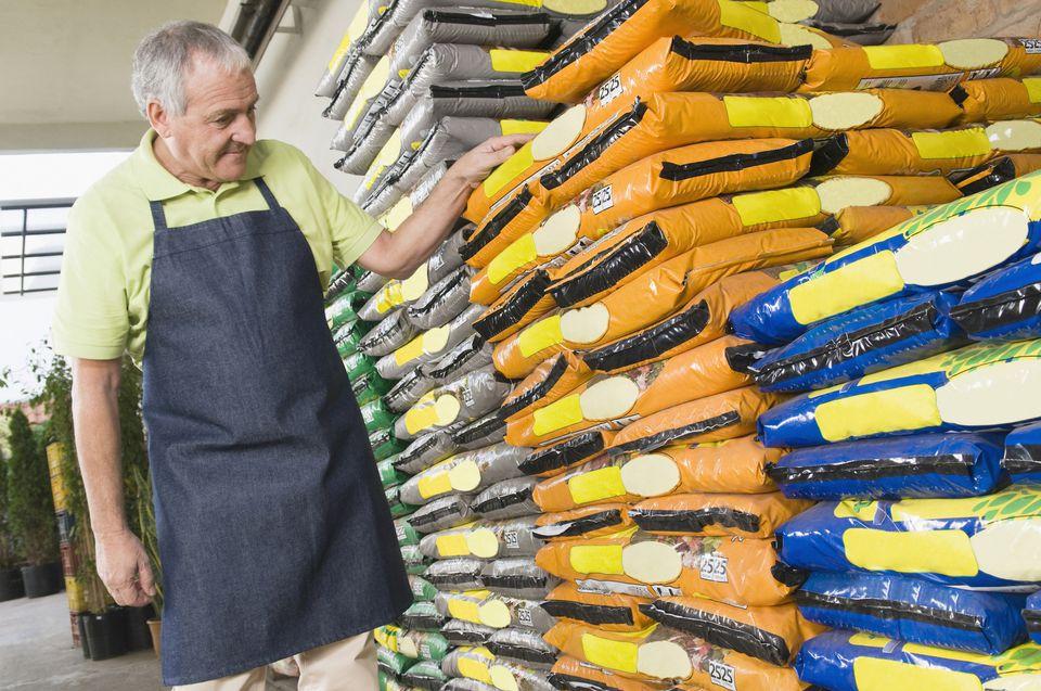 Man checking fertilizer in a garden center
