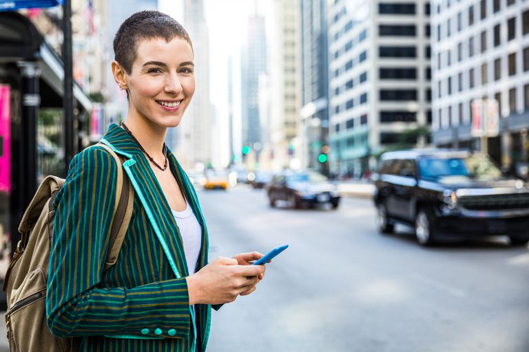 Woman with backpack and phone