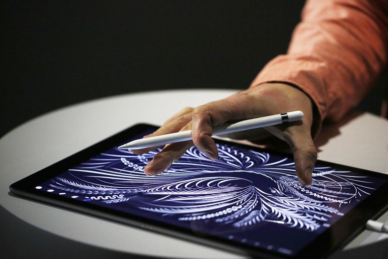 A man uses the new Apple Pencil on an iPad Pro after an Apple special event at Bill Graham Civic Auditorium September 9, 2015