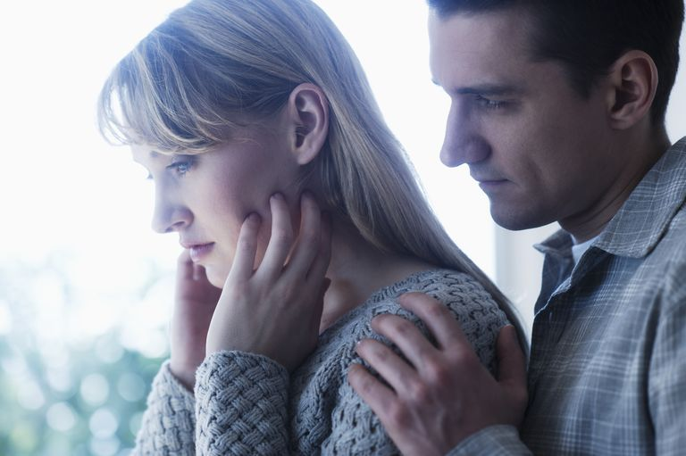 Sad couple worried about how to cope with the stress of infertility