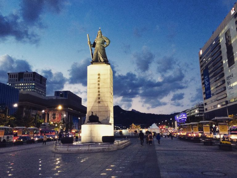 Low Angle View Of Admiral Yi Sun-Shin Statue In City Against Sky