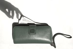 Shadow of hand removing money from wallet