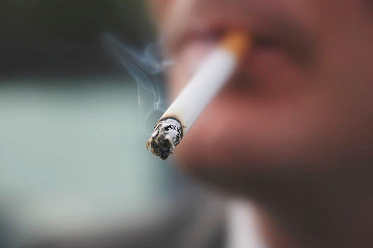close up of man smoking a cigarette