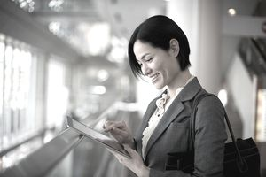 Woman holding a tablet