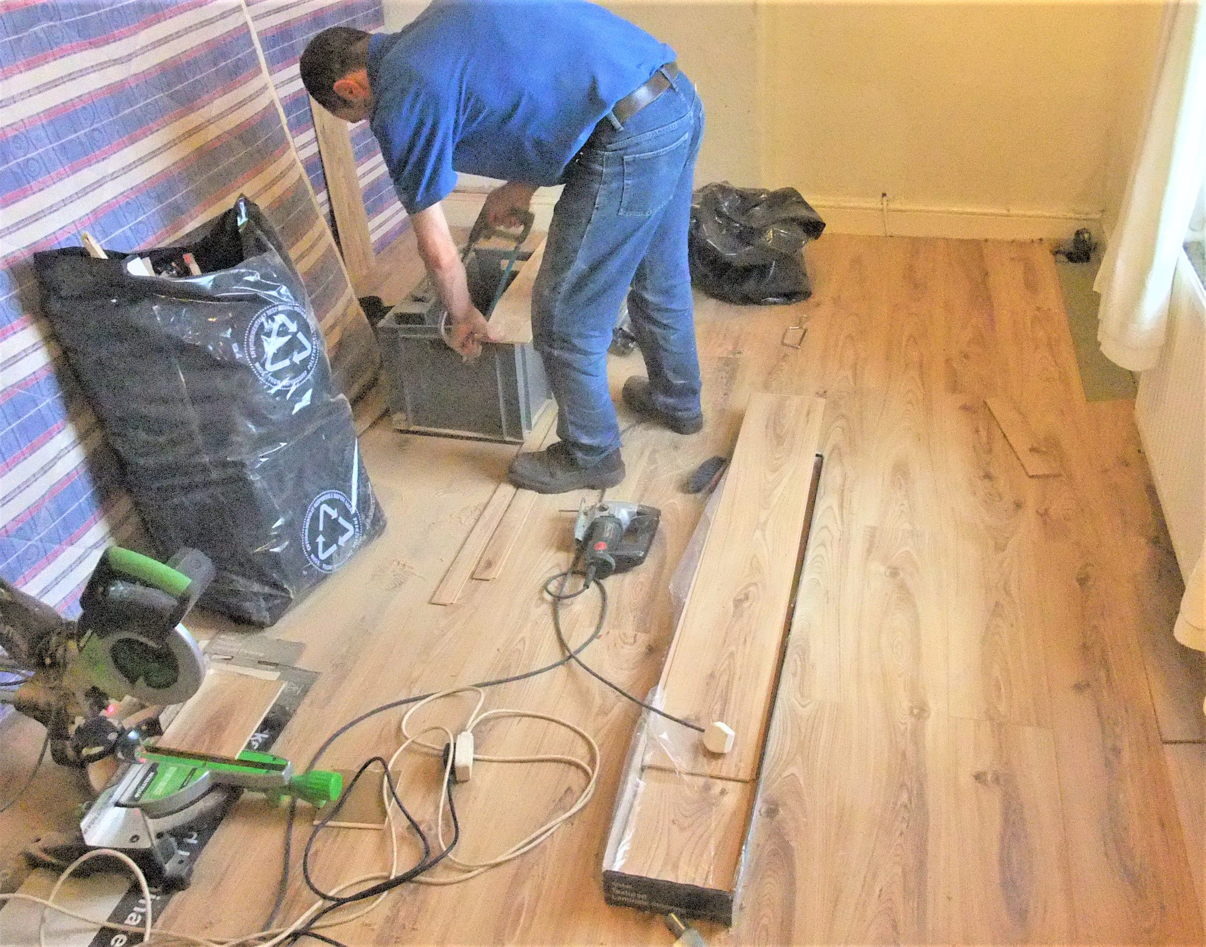 is residential tuesday under laminate flooring in floor much how january by blog filed install beach installed jacksonville aaa rehab