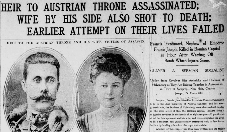 """Newspaper from 1914 headline reads: """"Heir to Austrian Throne Assassinated: Wife by His Side Also Shot to Death: Earlier Attempt on Their Lives Failed"""""""