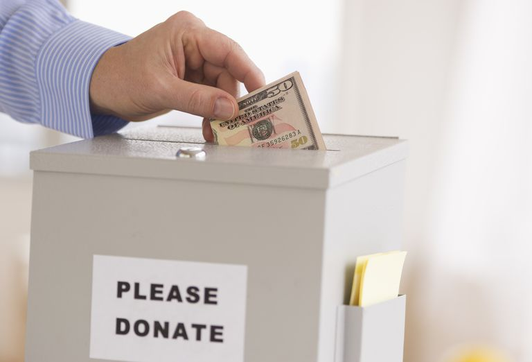 Jersey City, New Jersey, Man's hand putting dollars into donation box