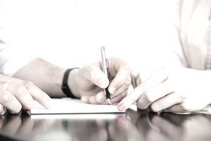 Man signing form, close up