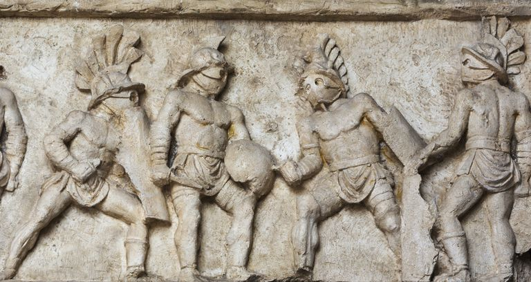 Rome, Italy. Bas relief of gladiators fighting.