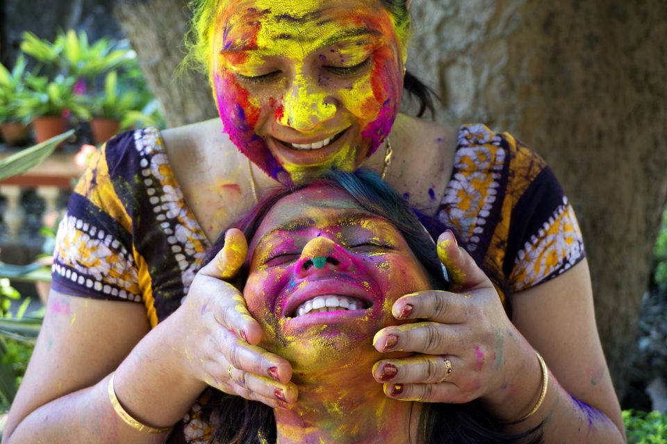 Mother and daugher celebrate Holi.