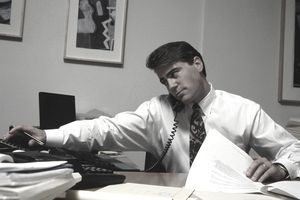 a businessman on the phone in an office