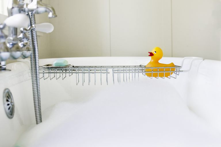 Rubber duck on rack over bathtub