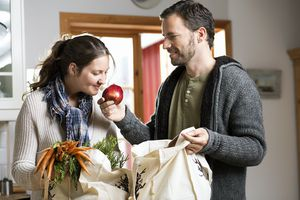 Couple unpacking groceries