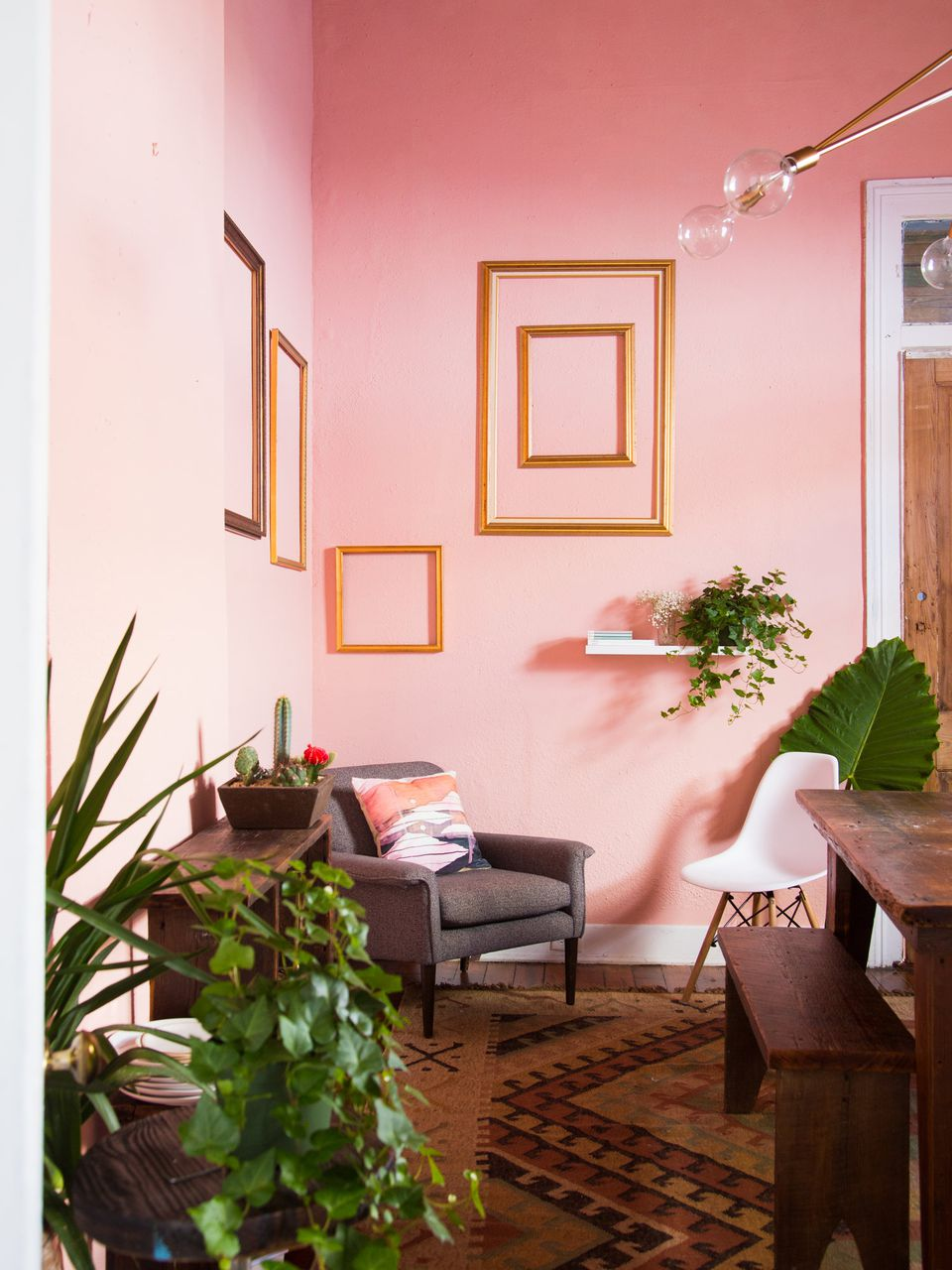 pink dining room gold frames on wall