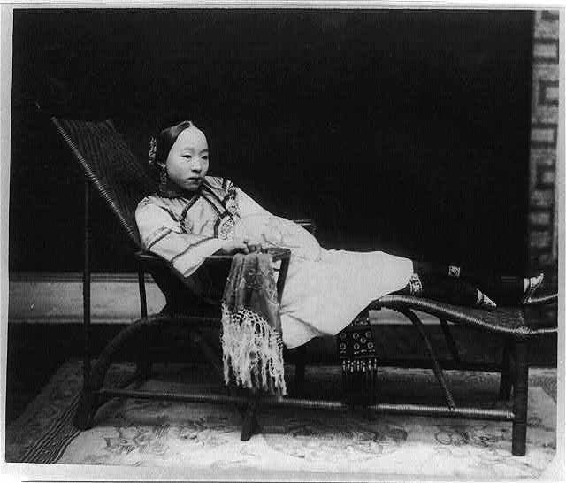 Chinese woman with bound feet on a chaise lounge, late Qing Era.