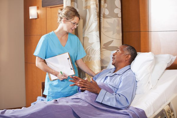 The bed alarm sounded so the nurse reminds him not to get up without help