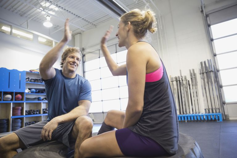 Athletes giving high five at the gym