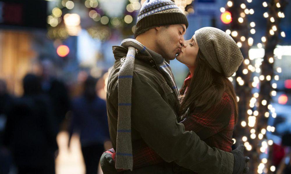 Couple kissing at night