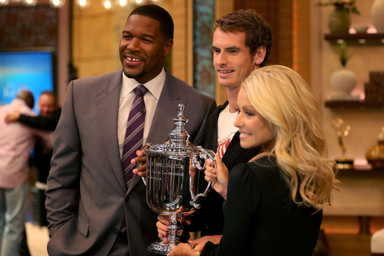 Andy Murray of Great Britain poses with the US Open Championship trophy next to Michael Strahan and Kelly Ripa on Live With Kelly and Michael during his New York City trophy tour.