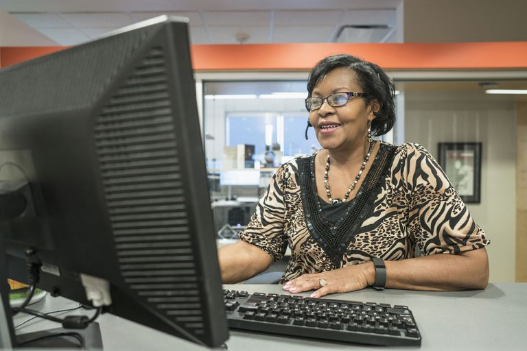 Black receptionist working in office