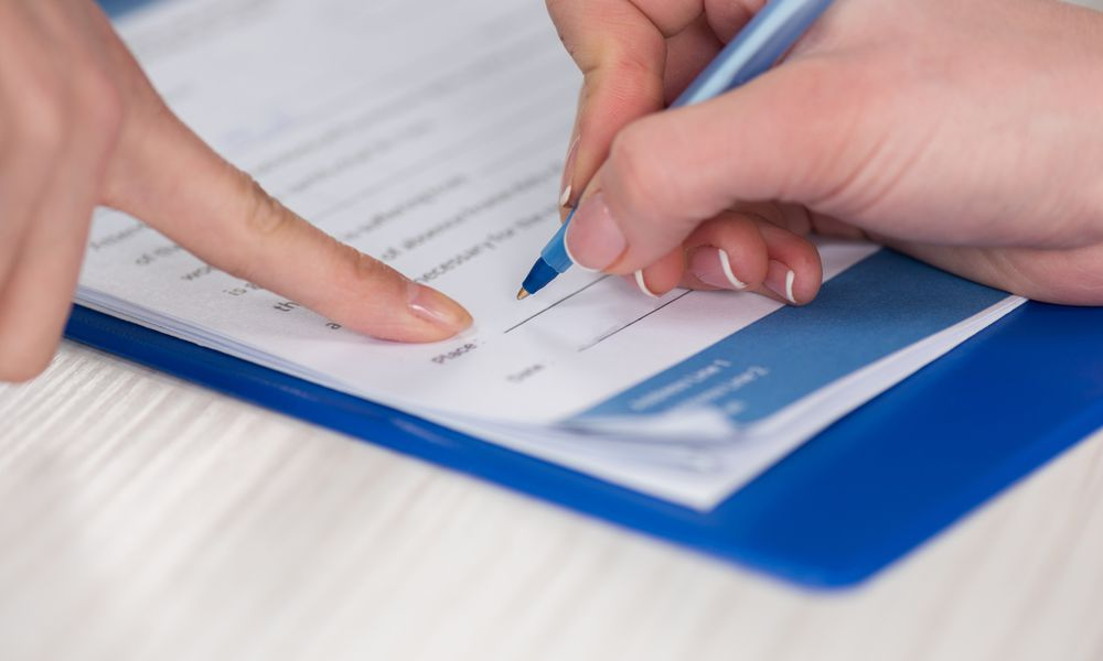 two female hands signing document