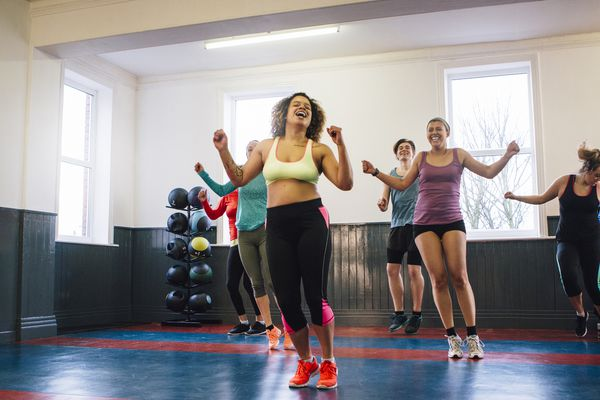 Women exercising in group fitness class