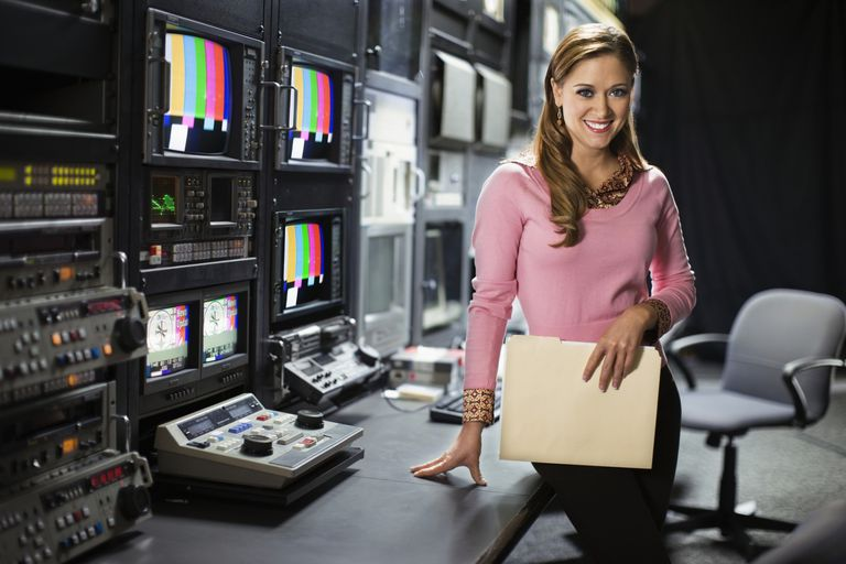 A photo of a TV news producer in a control room