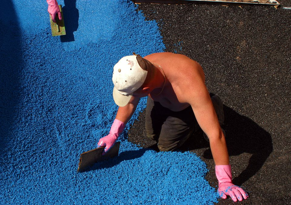 United Kingdom - Builder - Rubber mulching a playground
