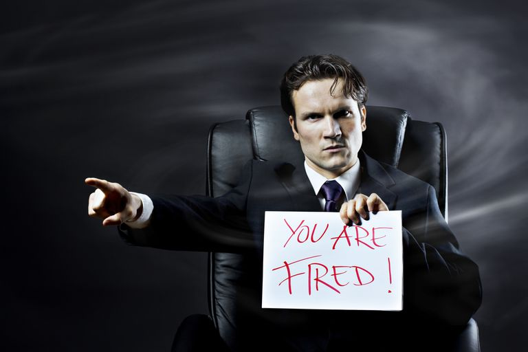 "man holding ""you are fired"" sign and pointing"
