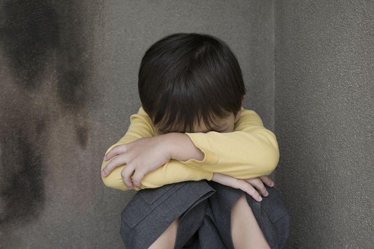Child Hiding in a corner
