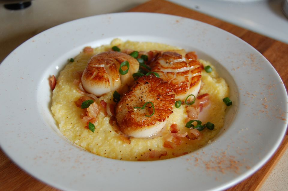 Pan-seared sea scallops with corn grits, bacon and sliced green onions