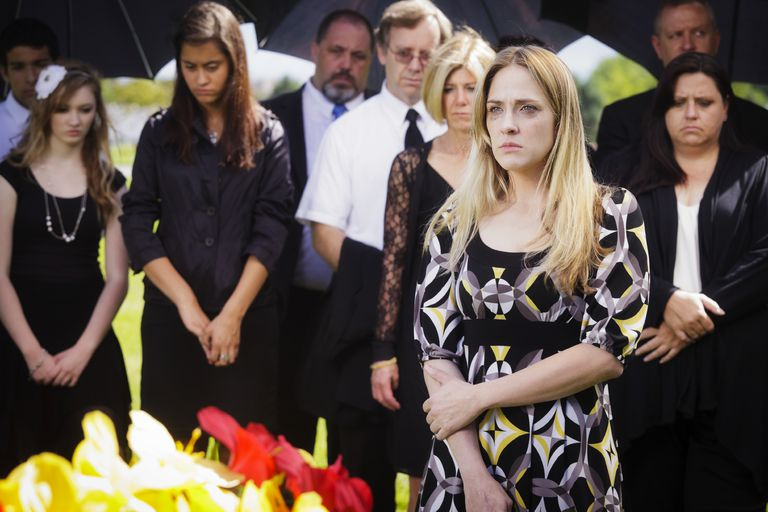 young woman mourning at a funeral