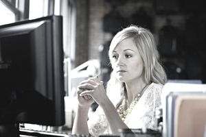 Woman looking at computer monitor