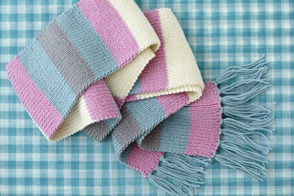 Striped woollen scarf on checked background